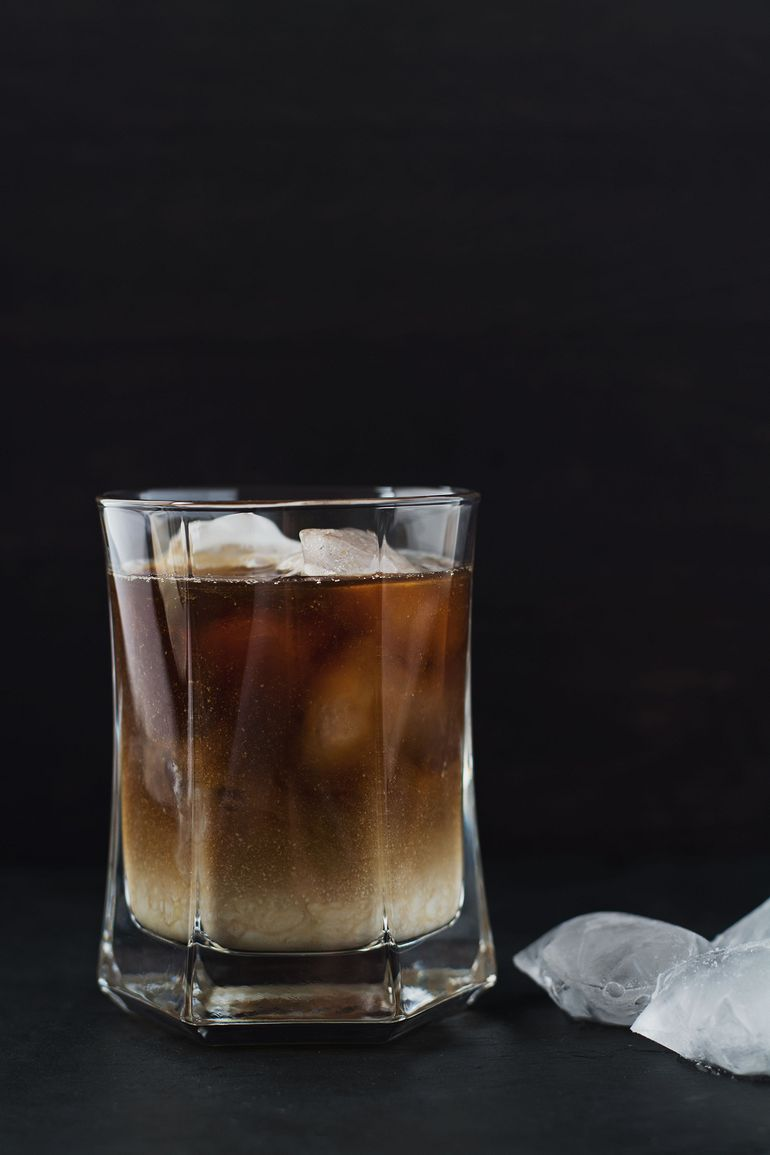 Iced coffee with ice cubes in a glass.